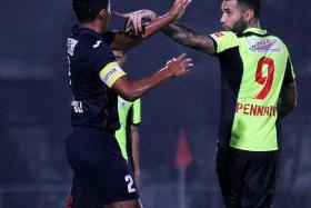 AGITATED: Jermaine Pennant (right) confronting Warriors captain Zulfadli Zainal (left) after a heavy tackle.
