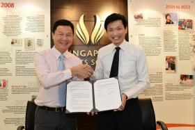 PARTNERSHIP: Singapore Sports School principal Tan Teck Hock (above, left) and Ngee Ann Polytechnic principal Clarence Ti signing a partnership which offers student-athletes more academic options.