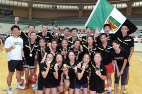 SWEET: Raffles Institution's players after proving too much for River Valley High School in both the Boys' and Girls' A Division finals.