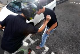 ATTACK: In Muhammad Fuad Kamroden's first instance of road rage, he head-butted and punched a man.