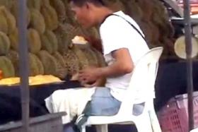 VIRAL: The clip shows the man making a jerking head movement over the exposed durian.