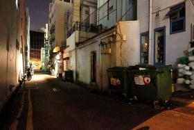 DITCHED: The back alley in Upper Circular Road, where the body of Myanmar national Myo Min Aung was found.