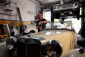 PASSIONATE: Mr Poon, who took over the business from his father in 1996, reckons that he has restored more than 2,000 vintage and classic cars.