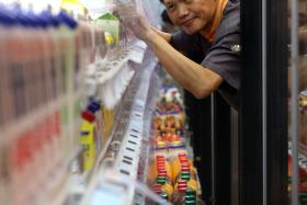 SERVICE: Mr Louis Chua works as a store assistant at FairPrice Finest's Changi Airport Terminal 3 branch.