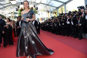 Czech model Petra Nemcova poses as she arrives on May 17, 2016 for the screening of the film Julieta at the 69th Cannes Film Festival in Cannes, southern France.