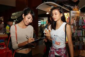 POTENTIAL MODEL: (Above) Myanmar national Khin Zarni Koko (left, in crop top) was also picked by New Face alumni.