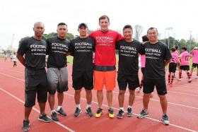DREAM TEAM: ActiveSG Football Academy principal Aleksandar Duric (in red) with coaches (from left to right) Hairil Amin, Hyrizan Jufri, Robin Chitrakar, Richard Bok and Steven Tan.