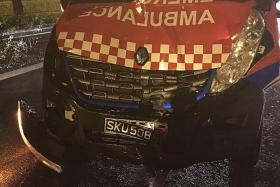 DAMAGE: The ambulance (above) collided into the white van.