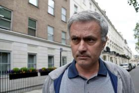 SPECIAL ONE'S IN TOWN: Jose Mourinho (above) is spotted outside his London home yesterday.