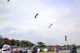 MYRIAD: (Above) Kite flyers gather at Marina Barrage on Sunday to fly big and small kites.