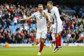 READY TO STRIKE: Jamie Vardy (right) and Harry Kane (left) both found the net for England against Turkey, showing signs of a promising partnership.