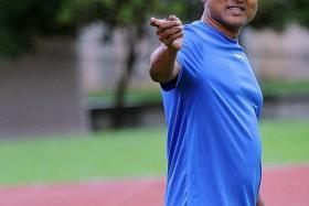 V Sundramoorthy as national coach. (above)