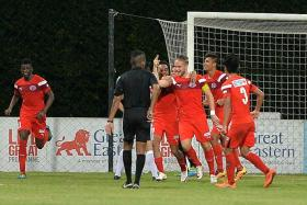 AGONY AND ECSTASY: Referee G Letchman (stretching his arm) turning away protests from some Hougang United players, after Home United had scored in injury time through Ken Ilso (above, with captain's armband).