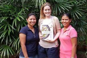 THE WRITE SOLUTION: Author Rowena 'Frog' Michaels with her Filipino maids, Ms Maricon Espiritu (left) and Ms Ginalyn Narag.