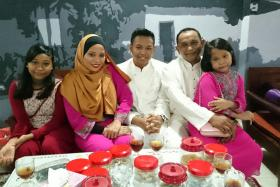 HEARTBROKEN: Mr Farid (second from right), his wife Madam Nurlina Salim (second from left) and their three children.
