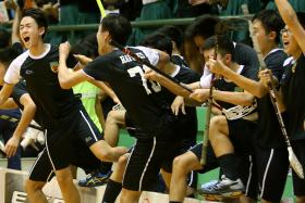 TEAM EFFORT: The Raffles Institution players celebrating at the final whistle.