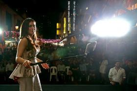 SELFIE TIME: (Above) Hansika Motwani capturing the crowd and posing with fan Prasaanth Ravindran.
