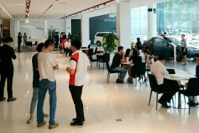 INTEREST: The crowd at a Toyota showroom yesterday.