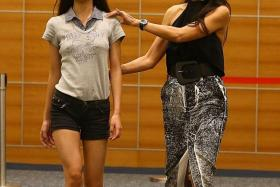 GLAMOUR: (Above) Finalist Vanessa Ho learning from 80s supermodel Ethel Fong.