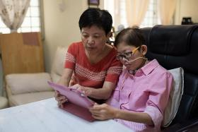 RARE DISEASE: Madam Grace Chin with her daughter, Miss Jane Tan, who suffers from a rare degenerative disease that slowly destroys the brain, nervous system, organs and muscles.