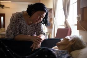 SUPPORT: Medical social worker Lola Ng with one of her patients.