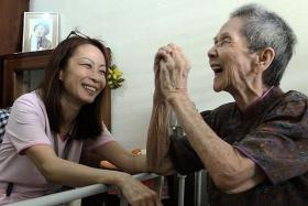 PALLIATIVE CARE: Nurse Amy Lim with one of her patients.