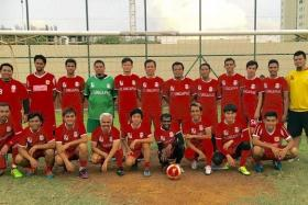 SUPPORT: (Above) Members of the Liverpool FC Official Supporters Club Singapore.
