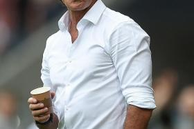 """""""It was the longest half-time break of my career. Luckily, nothing happened and no one was injured. We needed some time to adapt to the conditions as it was absolutely impossible to play any (passing) game"""". - Germany coach Joachim Loew (above) after rain, hail and lightning delayed the restart by some 20 minutes"""