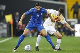TANGLE: (Above) Italy's Graziano Pelle (in blue) and Spain's Mikel Dominguez tussling during a 1-1 friendly draw in March.
