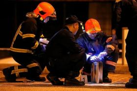 HELP: SCDF officers with the can containing flammable liquid that the man used to set himself on fire.