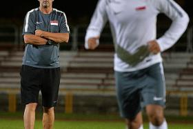 KEEPNG FOCUS: The Singapore U-21s at training under the the watchful eyes of coach Richard Tardy (above).