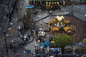 SCENE: The Erawan Shrine a day after the bombing on Aug 17 last year.