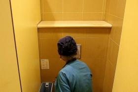 LOCATION: Madam Jumiati Amat showing the toilet and sanitary pad bin where she found the dead baby.