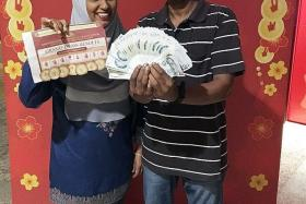 LUCKY: Madam Faridah Ibrahim, who won $6,000 in the previous TNP contest, and her husband, Mr Mohamed Kasim.