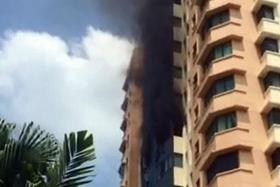 BURNING: A fire broke out in a 10th-storey unit at Simsville condo yesterday.