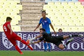 SORRY LIONS: Singapore Under-21s (in blue) finished the four-team tournament in last place.
