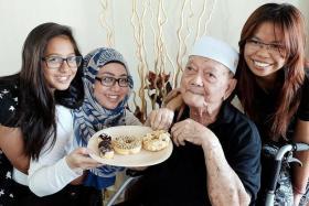 LONG LIFE: Mr Othman Nasir with (from far left) his granddaughter Nur Nadhrah S. Musa, daughter Norlela Othman and helper Setyani.