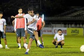 THREAT: Coach V Sundramoorthy is prepared to use Safuwan Baharudin (kicking the ball) as a target man due to his aerial prowess in Singapore's match against Vietnam.