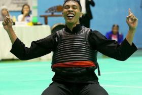 WINNER: Singapore's Alfian Juma'en won the gold in the men's class G (75-80kg) final against Vietnam's Nguyen Duy Tuyen at the Asian Pencak Silat Championships at the Bedok Sports Hall.