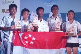 PROUD DAY: The Singapore team comprising (from far left) Daniel Ian Toh, Daniel Hung, Muhammad Daniel, Raynn Kwok and Jodie Lai finished second, while Muhammad was first in the individual category in Sri Lanka.