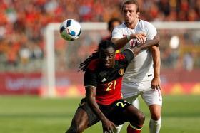 LEFT BACK LUKAKU: Belgium's Jordan Lukaku, younger brother of Everton striker Romelu, keeping Norway's Veton Berisha at bay.