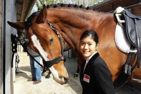 SPECIAL HORSE: Miss Foo with Cassis Royal, the horse that is specially trained to suit her needs.