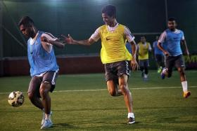 LIONS IN ACTION: National team stars Hariss Harun (left) and Safuwan Baharudin tussle for the ball.