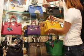 BAG LADY: Primary school teacher A.L. Soh with the display of her bags in her walk-in closet.
