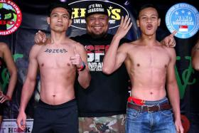 """CONFIDENT WAN: Singapore pro boxer Ridhwan """"The Chosen Wan"""" Ahmad (right) intends to finish his bout with Indonesia's Egi Rozten (left) in four rounds."""