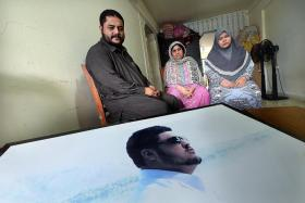 GRIEVING: (Above, from left) Mr Ravaid's father, Mr Abdul Aziz Khan, his mother, Madam Fajrah, and his wife, Mrs Ravina Khan, are filled with sorrow.