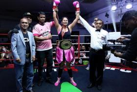 FEMME FATALE: Nurshahidah Roslie savours her sweet victory.