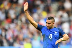 France's forward Dimitri Payet celebrates after scoring the 2-1 during the Euro 2016 group A football match between France and Romania at Stade de France.