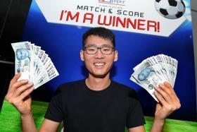 WINNERS: (Above) Mr Tham Jia Jun won the $2,000 jackpot.