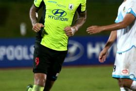 CLOSING THE GAP: Jermaine Pennant (left) popping up with the winner to hand Tampines the win that puts them seven points behind leaders Albirex Niigata.